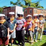 UD Students suited up to tend bees.