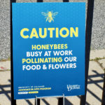 Caution honeybees at work sign.